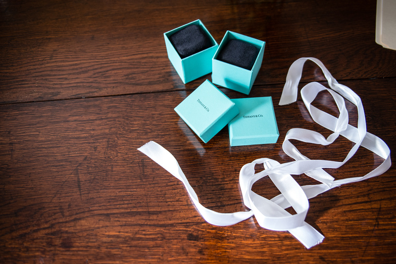 Tiffany and Co. wedding rings at an in-home ceremony in Washington, DC. Goodshuffle shares when to splurge and when to save to make the most out of your budget without compromising your wedding photographs! Photos from the Harty, Washington DC, Rentals